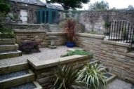 Edinburgh garden designers - note terracing and stone retaining walls.