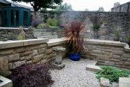 Edinburgh landscapers - note retaining wall built using randowm rubble.